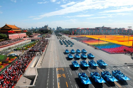 Armored vehicles roll down the street during a parade to mark the 60th anniversary of the founding of the People's Republic of China, in central Beijing October 1, 2009. (REUTERS/Xinhua/Xie Huanchi)